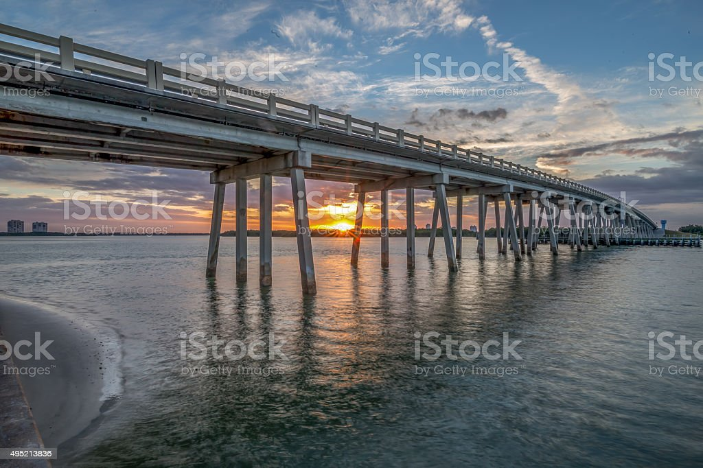 Bridge at dawn with shoreline stock photo