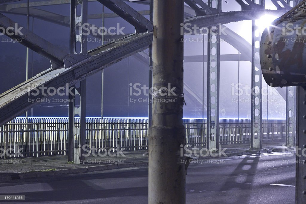 Bridge at night in the fog royalty-free stock photo