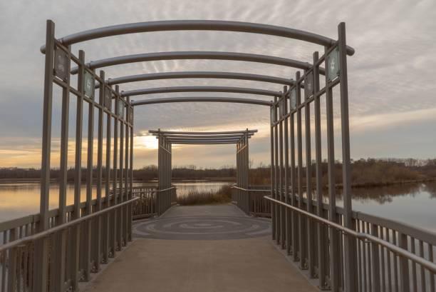 Bridge at sunset on the boardwalk over Purgatory Creek stock photo