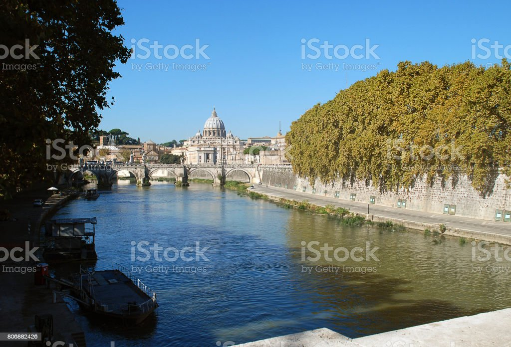Bridge, basilica and the river Tiber in Rome stock photo