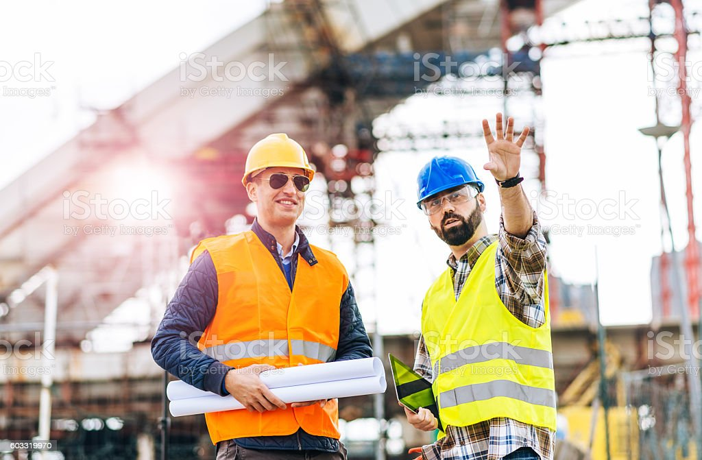 Bridge builders in modern world stock photo