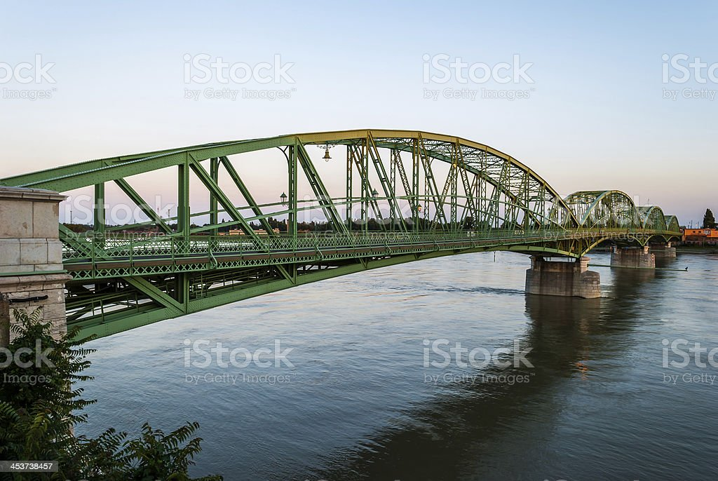 Bridge connecting two countries, Slovakia and Hungaria before sunset stock photo