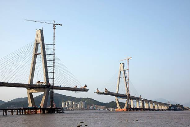 Bridge Construction Sea bridge under construction bridge built structure stock pictures, royalty-free photos & images
