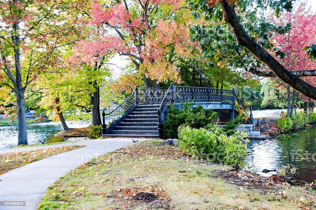 Bridge crossing lake in Roger Williams Park stock photo