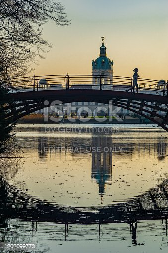 Berlin, Germany- november 16, 2018: Bridge crossing the Lake of Charlottenburg Palace in evening sunshine