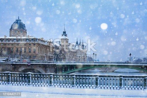 View from bridge d'Arcole on pont Notre Dame under snow in Paris during flood