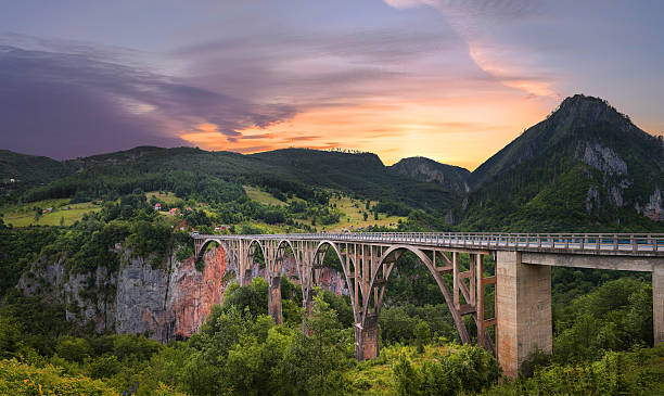 bridge dzhurdzhevicha. montenegro - serbia stock photos and pictures