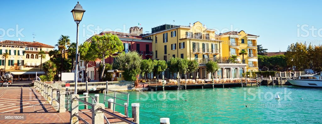 Bridge embankment yacht pier Lake Garda restaurants hotels luxur royalty-free stock photo