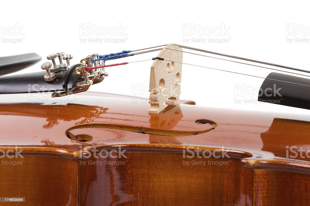 Bridge, f-hole and fine tuners on a violin stock photo