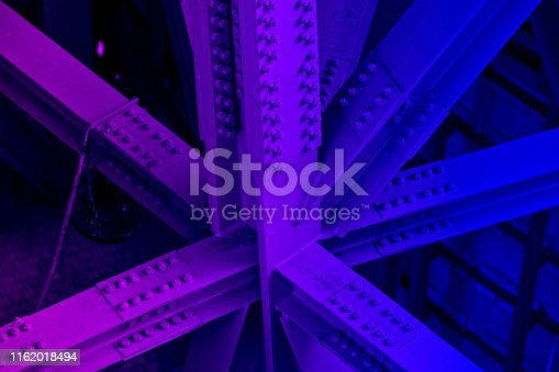 Bridge frame closeup neon colored. Horizontal purple and blue glowing toned image