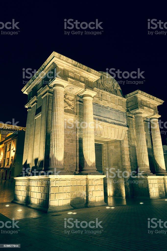 Bridge Gate (Puerta del Puente) triumphal Renaissance arch illum stock photo