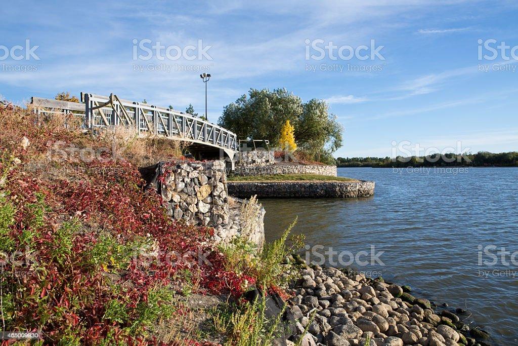 Bridge in autumn at Trafagar Overlook and Pond in Regina stock photo
