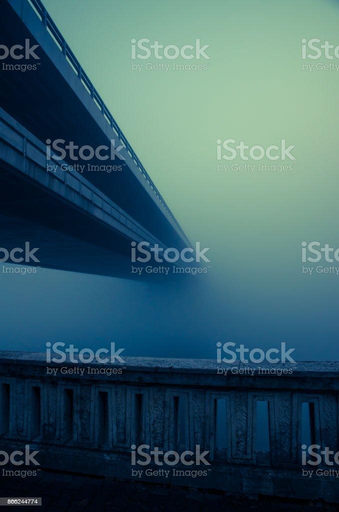bridge in autumn fog stock photo