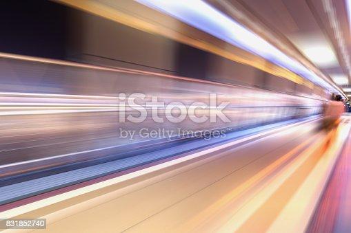 istock bridge in radial blur in night with lights on 831852740