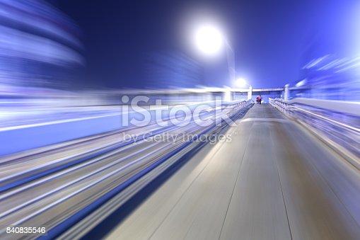 istock bridge in radial blur in night with lights on 840835546