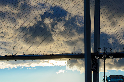 istock bridge in the background of thunderclouds 1141906495