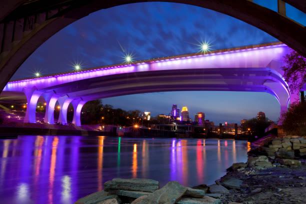 35W Bridge Minneapolis Illuminated in Purple Lights Tribute to Prince Minneapolis, Minnesota USA - April 23, 2016: I-35W Bridge in Minneapolis Illuminated with Purple Lights a Tribute to Musician Prince  prince musician stock pictures, royalty-free photos & images