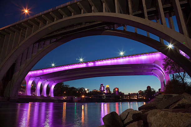 I-35W bridge Minneapolis lit with purple in honor of Prince Minneapolis, Minnesota, USA - April 22, 2016: The I-35W bridge in Minneapolis lit with purple lights in honor of the death of music legend Prince. prince musician stock pictures, royalty-free photos & images