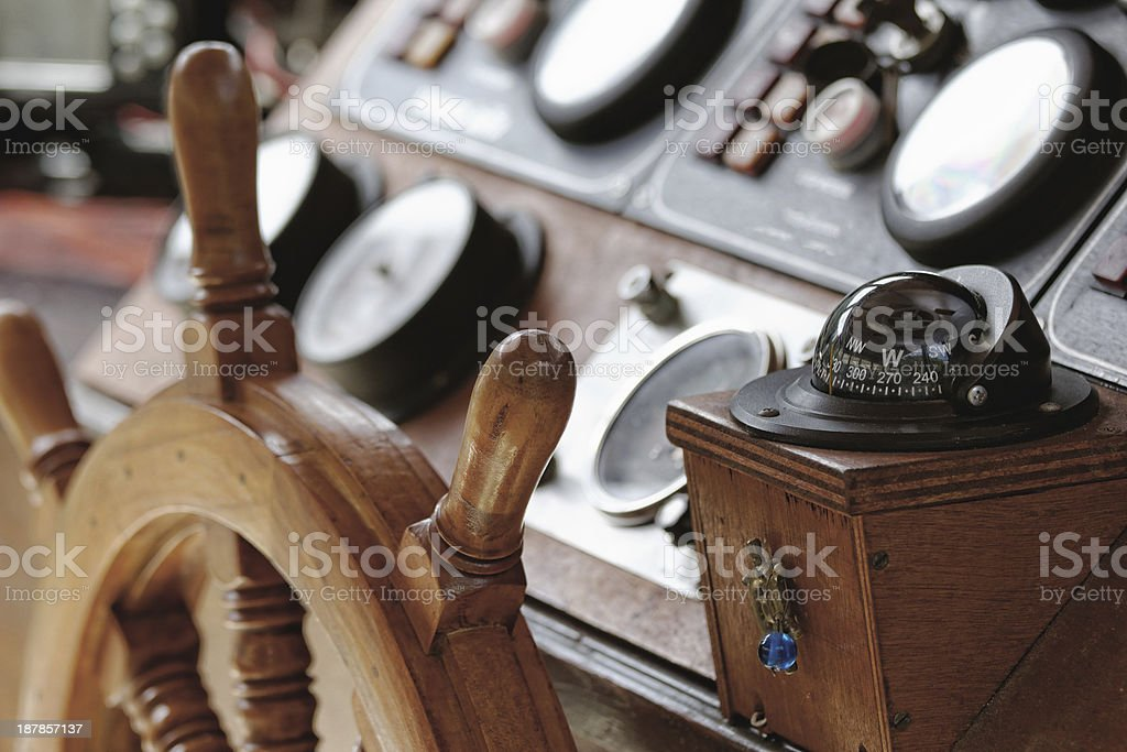 bridge of a ship's steering wheel and compass stock photo