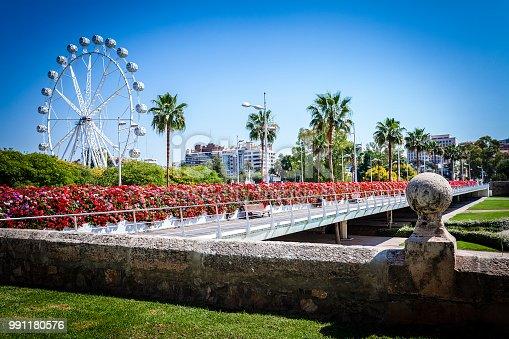 Puente de las flores bridge in Valencia, Spain with a ferris wheel at background
