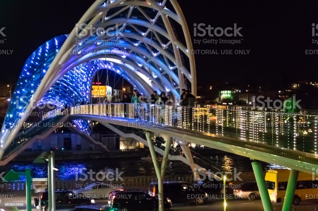Bridge of Peace in Tbilisi. Pedestrian bridge over the Kura river at night - Royalty-free Architecture Stock Photo