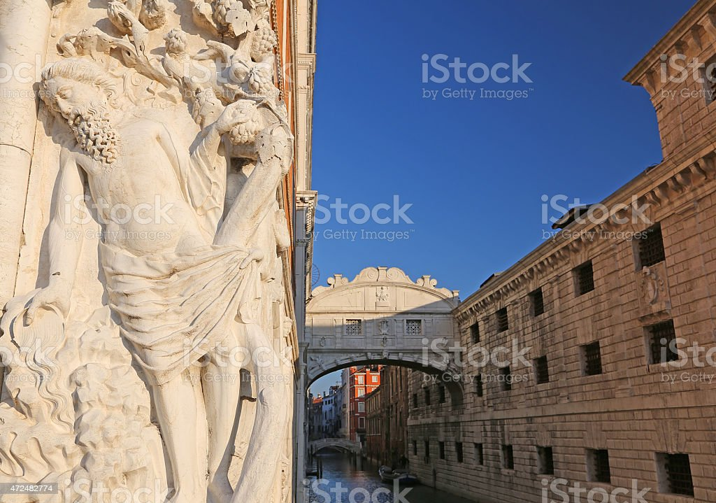 bridge of sighs in Venice in Italy with a statue stock photo