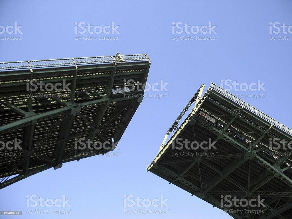 Bridge opening up to let boat through stock photo