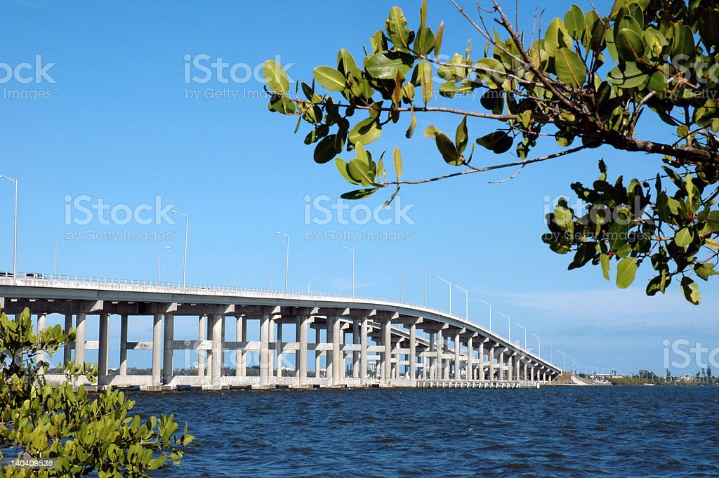 Bridge or causeway across river stock photo