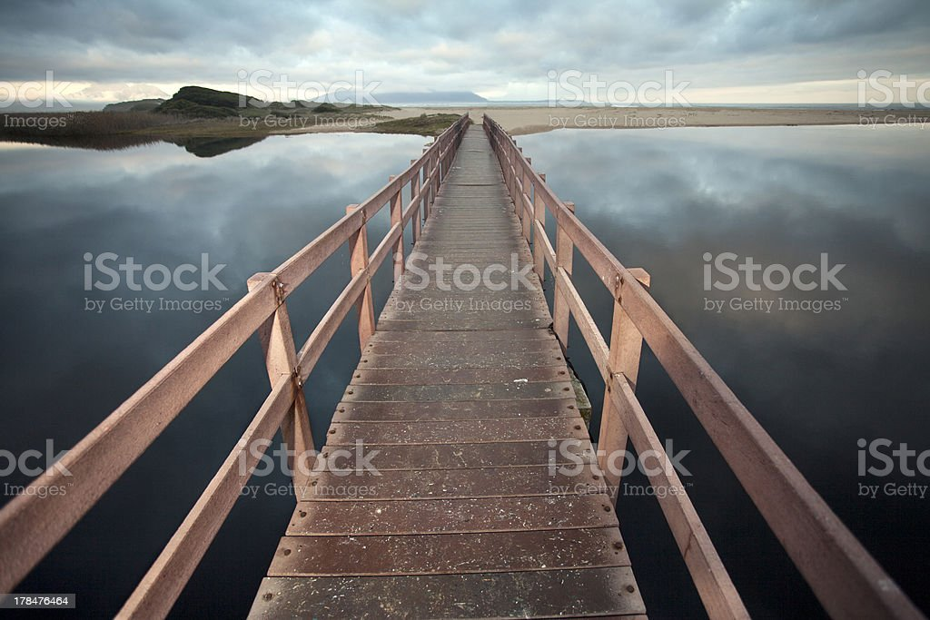 Bridge over calm water stock photo
