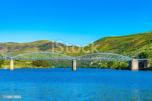 Bridge over Douro river leading to Pinhao village in Portugal