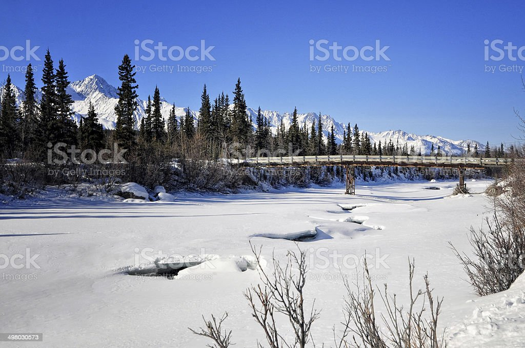 Bridge Over Frozen Water stock photo