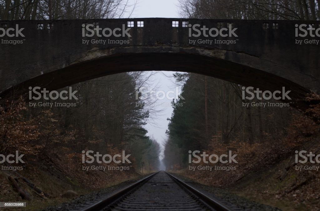 Bridge over misty railway stock photo