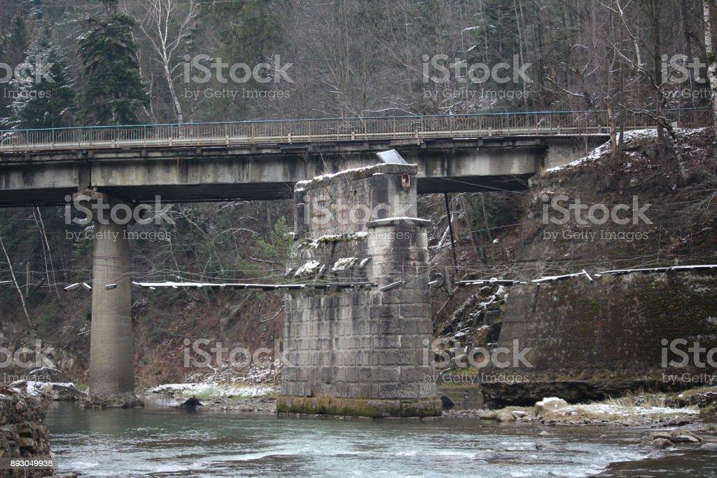 bridge over mountain river stock photo