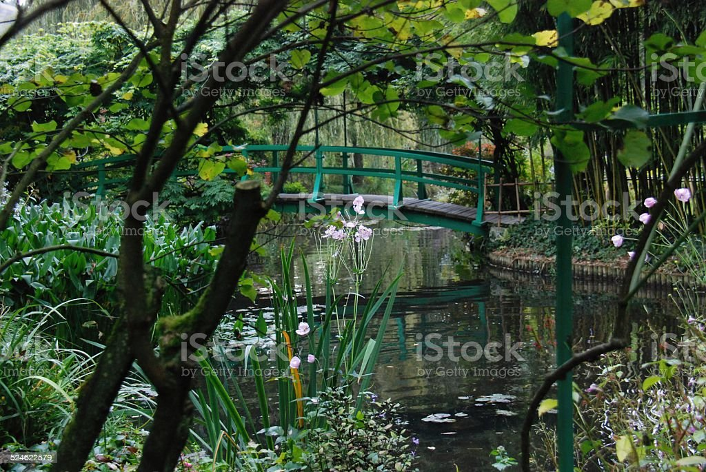 Bridge over Pond of Water Lilies, Giverny pained by Monet stock photo