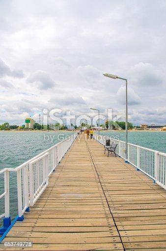 Bridge over the Black Sea from Mamaia, Romania. Blue water, clouds, blue sky.