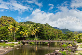 Buccament Bay, St Vincent and the Grenadines - December 19, 2018: View of the bridge over the Buccament river in Buccament Bay, Saint Vincent island, Saint Vincent and the Grenadines.