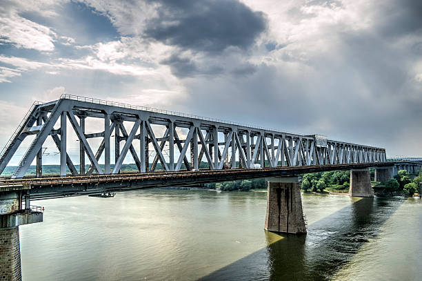 Bridge Over The Danube River - HDR Image Tone mapped HDR image of a bridge over the Danube river. railway bridge stock pictures, royalty-free photos & images