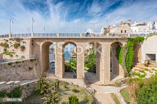 Bridge over the famous Lama Monachile beach in Polignano a Mare, Apulia, Italy.
