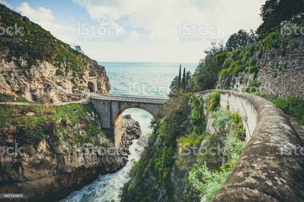 bridge over the fjord of furore, amalfi coast, italy stock photo