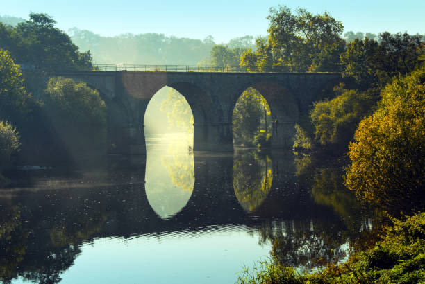 Bridge over the  Orne River, Normandy,  France Landscape with a bridge with arches  reflected in  the Orne River , located in the Calvados department in Normandy. calvados stock pictures, royalty-free photos & images