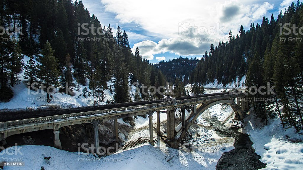 Bridge over the Payette river covered in snow stock photo