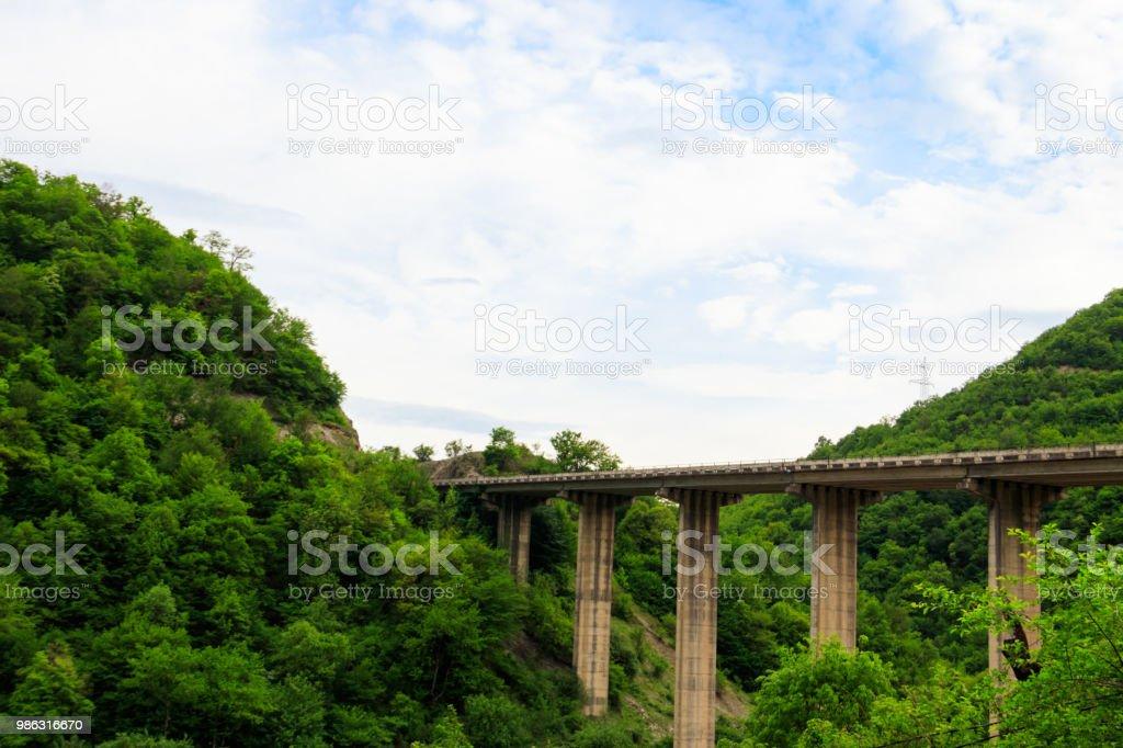 Bridge over the precipice in the mountains near Ananuri fortress, Georgia