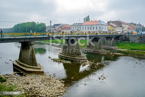 istock Uzhgorod, Ukraine - September 18, 2016: Bridge over the river Uzh in Uzhhorod 1253325882