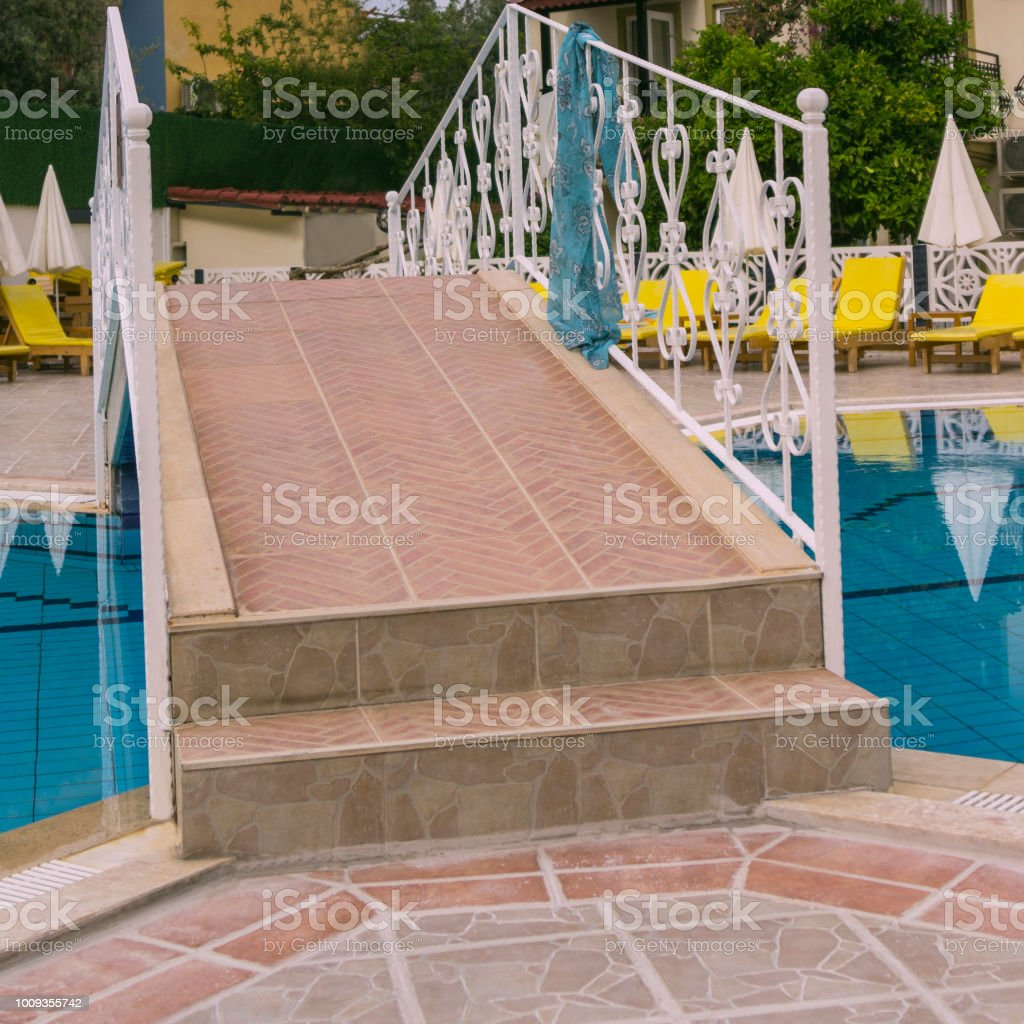 Bridge Over The Swimming Pool Yellow Sunbeds And White Sun ...