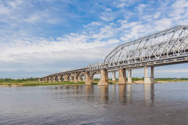 Cтоковое фото Bridge over the Volga River with reflection in water, Nizhny Novgorod