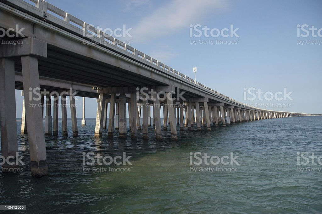 Bridge over turquoise water stock photo