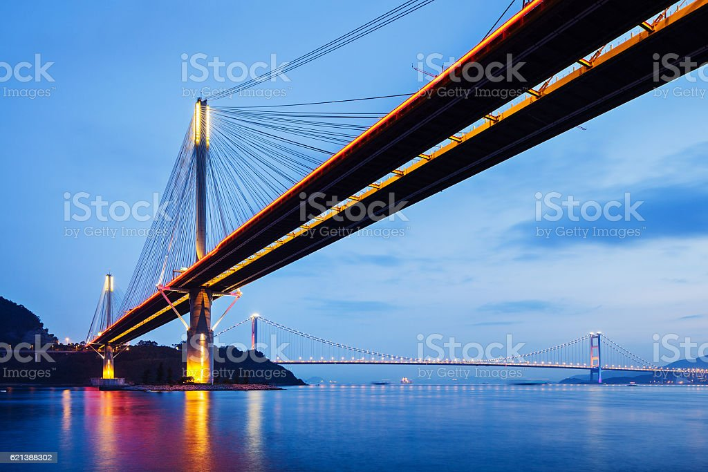 Bridge over water at dusk stock photo