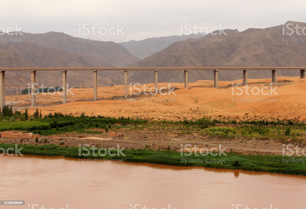 Bridge over Yellow river (Huang He) in Tengger desert, Shapotou district, China stock photo