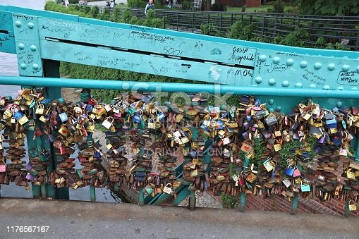 Symbolic love padlocks on Tumski Bridge in Wroclaw, Poland. The locks are harmful to bridge's structure and need to be removed on regular basis.