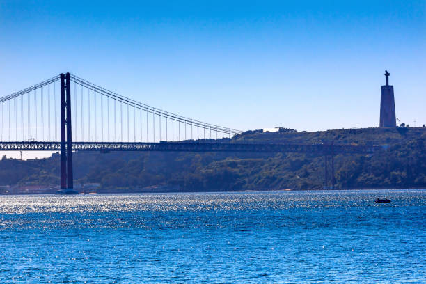 bridge ponte 25 april tagus river belem lisbon portugal - cristo rei lisboa imagens e fotografias de stock